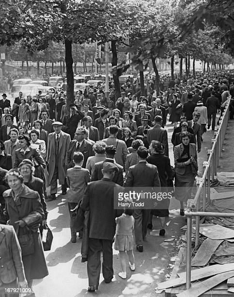 On the day before Coronation Eve thousands of excited people are visiting London to see the sights Crowds seen here filing through the Mall 31st May...