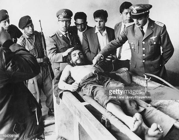 On the day following his execution, the body of Argentinian Communist revolutionary leader Ernesto 'Che' Guevara is put on display in the laundry...