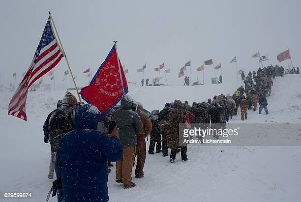 On the day of a government order to vacate the area, hundreds of United States military veterans vow to defend the Standing Rock protest camp and...
