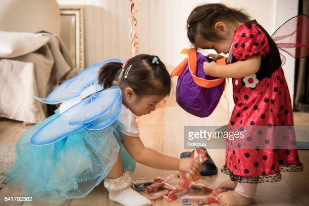 on the day of halloween, the girls got sweets. - halloween candy stock photos and pictures