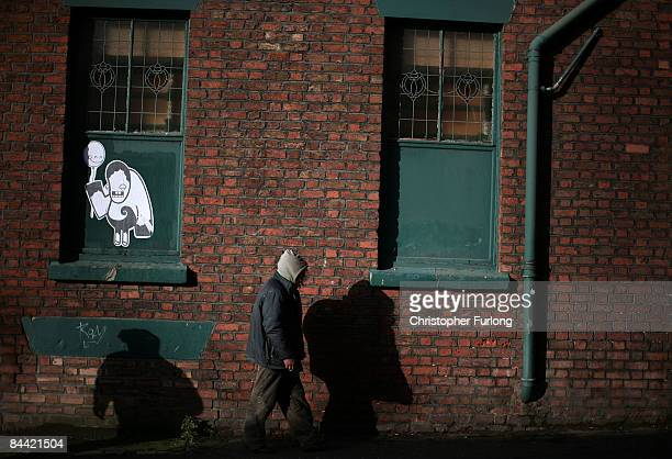 On the day that Britain officially enters a recession a homeless man walks the streets on January 23 2009 in Liverpool United Kingdom Figures...