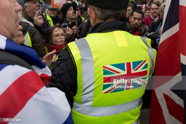 On the day that Prime Minister Theresa May's Meaningful Brexit vote is taken in the UK Parliament a farright 'yellow jacket' heckles protesting...