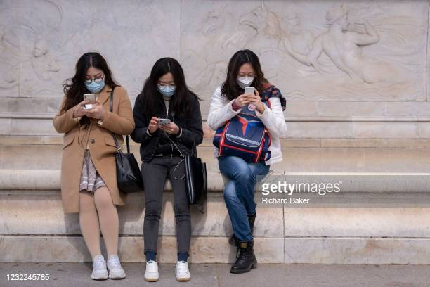 On the day that the death of the Duke of Edinburgh was announced, three Asian visitors at the foot of the Victoria Memorial, opposite Buckingham...