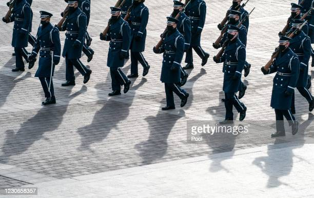 On the East Front steps of the U.S. Capitol, lined by Honor Guard during Pass Review, lawmakers' staff and Sergeant at Arms staff run through the...