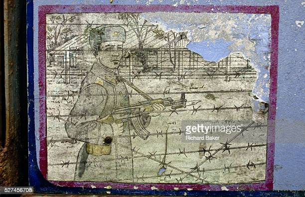 On the edge of an old Soviet parade ground peeling murals show an instruction mural for guarding prison camps seen in this army boot camp in the...