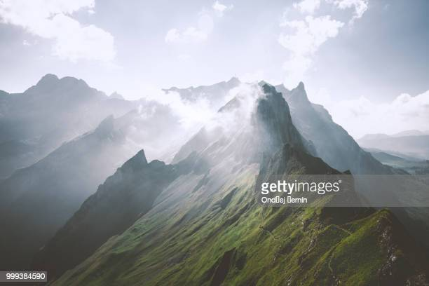 on the edge of the clouds.. - switzerland stock pictures, royalty-free photos & images