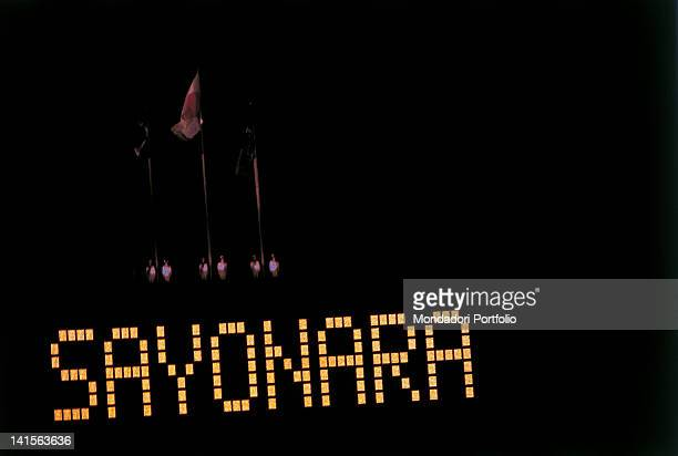 On the electronic scoreboard, which was used to indicate athletes performances during the Games of the XVIII Olympiad, a word is lit during the...
