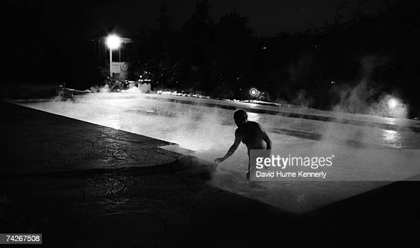 On the eve of Jimmy Carter's inauguration, President Gerald R. Ford emerges after taking a final swim in the White House swimming pool on January 19,...