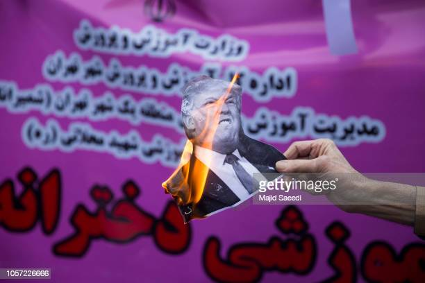 On the eve of renewed sanctions by Washington Iranian protesters trample on an Israeli flag during a demonstation outside the former US embassy in...