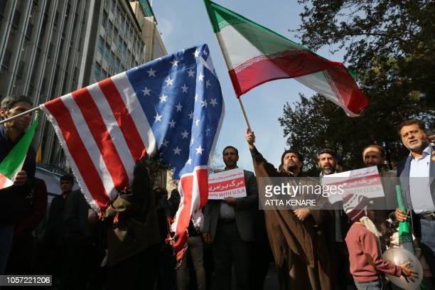 On the eve of renewed sanctions by Washington Iranian protesters demonstate outside the former US embassy in the Iranian capital Tehran on November 4...
