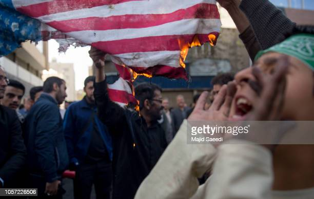 On the eve of renewed sanctions by Washington Iranian protesters demonstate outside the former US embassy marking the anniversary of its storming by...