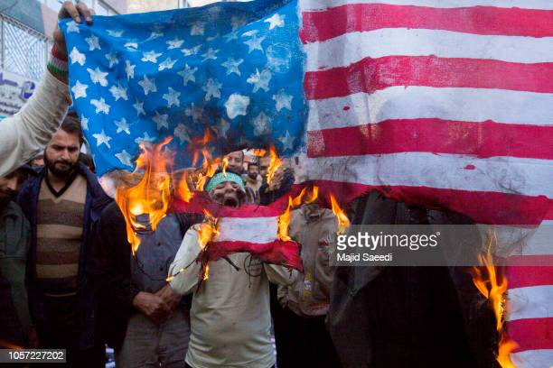 On the eve of renewed sanctions by Washington, Iranian protesters demonstate outside the former US embassy in the Iranian capital Tehran on November...