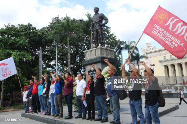 On the eve of the 156th Bonifacio Day, militants groups staged a rally at the monument of Andres Bonifacio in Manila carrying their placards of...