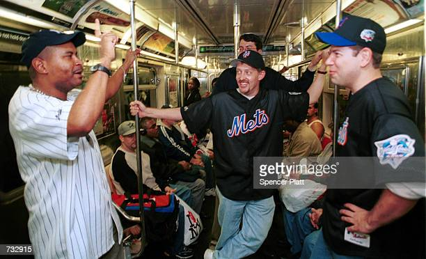"""On the eve of the first New York """"Subway Series"""" in 44 years, Yankees and Mets fans exchange words on the number 4 subway train October 21, 2000 en..."""