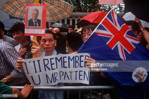 On the eve of the historical Handover of sovereignty of Hong Kong from Britain to China proUK Chinese gather in the rain outside the official...
