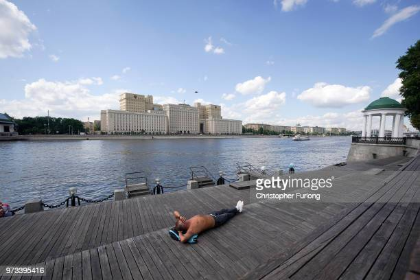 On the eve of the World Cup a man sunbathes on the banks of the Moskva River on June 13 2018 in Moscow Russia On the eve of the first game of the...