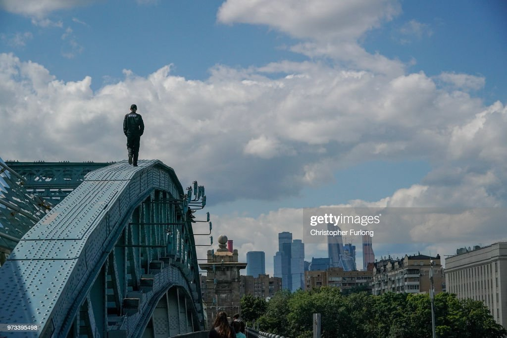 On the eve of the World Cup a security guard checks the top of a bridge to prevent teenagers doing selfies on June 13, 2018 in Moscow, Russia. On the eve of the first game of the World Cup it was announced that the 2026 World Cup will be held in the United States, Canada and Mexico. FIFA expects more than three billion viewers for the World Cup which begins tomorrow.