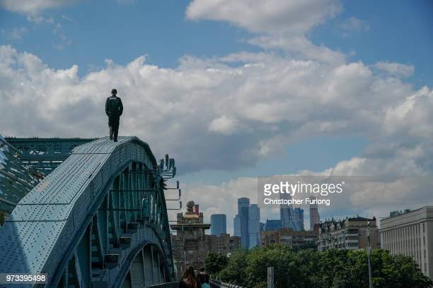 On the eve of the World Cup a security guard checks the top of a bridge to prevent teenagers doing selfies on June 13 2018 in Moscow Russia On the...