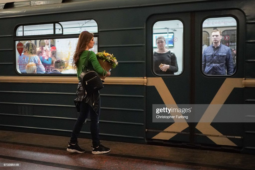 On the eve of the World Cup a woman carries flowers as she travels on the Metro on June 13, 2018 in Moscow, Russia. On the eve of the first game of the World Cup it was announced that the 2026 World Cup will be held in the United States, Canada and Mexico. FIFA expects more than three billion viewers for the World Cup which begins tomorrow.