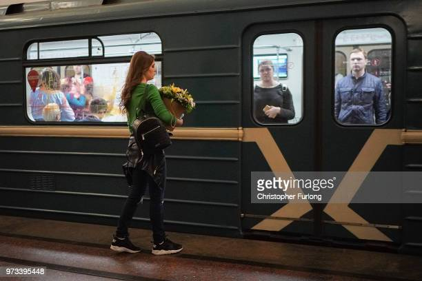On the eve of the World Cup a woman carries flowers as she travels on the Metro on June 13 2018 in Moscow Russia On the eve of the first game of the...
