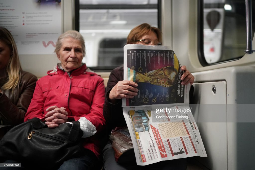 On the eve of the World Cup a woman reads a newspaper with The World Cup pictured on the front page on June 13, 2018 in Moscow, Russia. On the eve of the first game of the World Cup it was announced that the 2026 World Cup will be held in the United States, Canada and Mexico. FIFA expects more than three billion viewers for the World Cup which begins tomorrow.