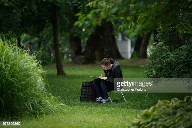 On the eve of the World Cup a woman sketches in Gorky Park on June 13 2018 in Moscow Russia On the eve of the first game of the World Cup it was...