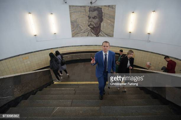 On the eve of the World Cup aman gestures to the camera as he emerges from the Metro on June 13 2018 in Moscow Russia On the eve of the first game of...