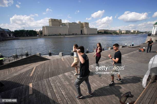 On the eve of the World Cup people relax and dance on the banks of the Moskva River on June 13 2018 in Moscow Russia On the eve of the first game of...
