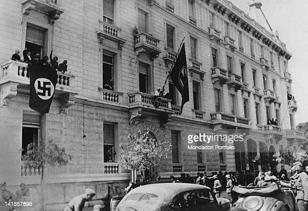 On the facade of an Athens building requisitioned by the Wehrmacht fly the German flags with Nazi symbols. Athens, May 1941