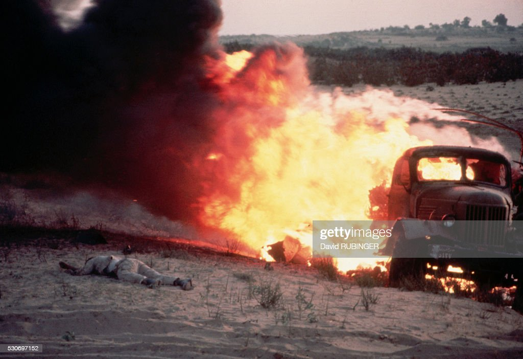 On the first day of the Six Day War, I was in a half-track with General Israel Tal's division. As we headed for Rafiah and El Arish through the Gaza Strip, an Egyptian truck ahead of us was hit by an Israeli plane. The picture of the flaming truck and thedead soldier best told the story that Israel and Egypt were again at war. TIME used it as the background for its Six Day War cover that featured a portrait of Defense Minister Moshe Dayan and LIFE printed it over a double-page. In another armored column,racing parallel to us toward Gaza, was LIFE's star photographer Paul Schutzer. Paul and I had a bet going that the first one to get a LIFE cover out of the war would buy champagne. Luck was against him. Heading towards Gaza, Paul's half-track sustained a direct hit. I won the bet but there was no one to buy champagne for.