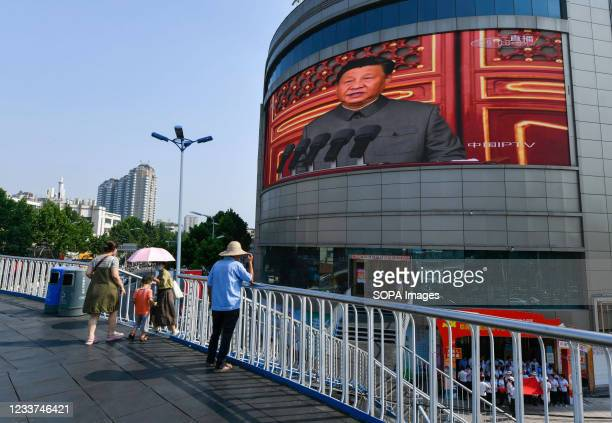 On the giant screen of Renmin Road in Fuyang, Xi Jinping seen giving a speech during the Centenary Celebration of the founding of the Chinese...