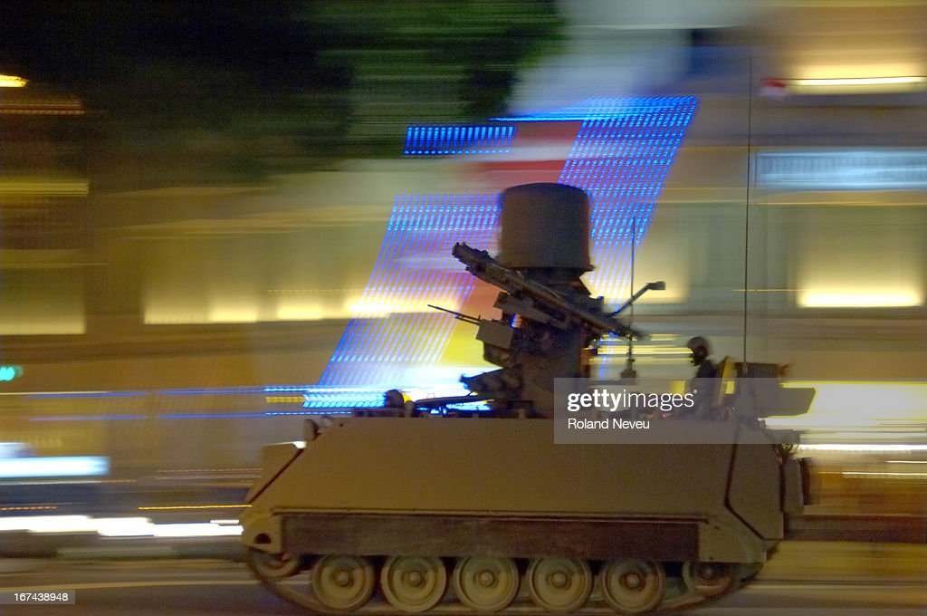 On the independence day celebration, armour military gear drive through the street of Singapore at night in a show of force..