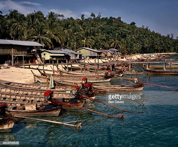 On the island of Ko Samet in Thailand's Gulf of Thailand tourists can enjoy spectacular white sandy beaches palm trees and fishing boats making this...