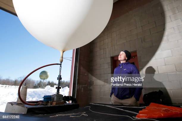 On the Job Margaret Curtis meteorologist for the National Weather Service inflates a weather balloon with helium Balloons are launched from NWS sites...