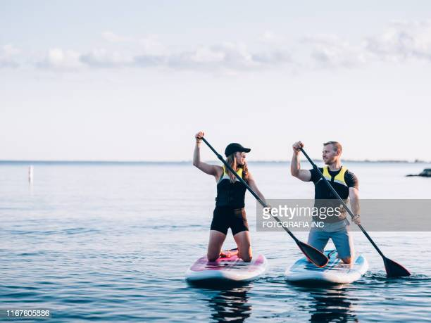 on the lake - paddling stock pictures, royalty-free photos & images