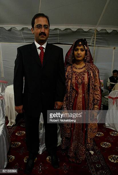 On the last day of a 3 day marriage ceremony a newlywed Pakistani couple pose for their photograph at a relative's house January 10 2005 in Islamabad...
