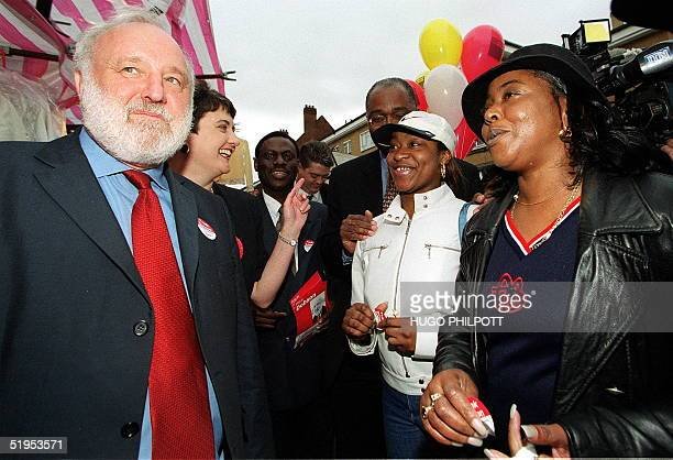 On the last day of campaigning Labour's mayoral candidate Frank Dobson looks in a downcast mood while on a walkabout in London's East St market 03...