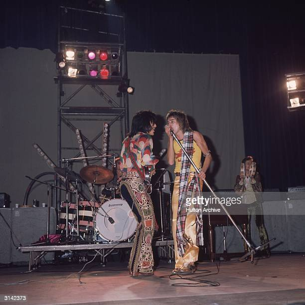 On the left Ron Wood of 'The Faces' on stage with Rod Stewart