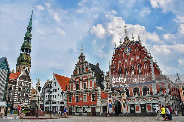 the town hall on the right The building of the Brotherhood of Blackheads a guild for unmarried German merchants in Riga Latvia