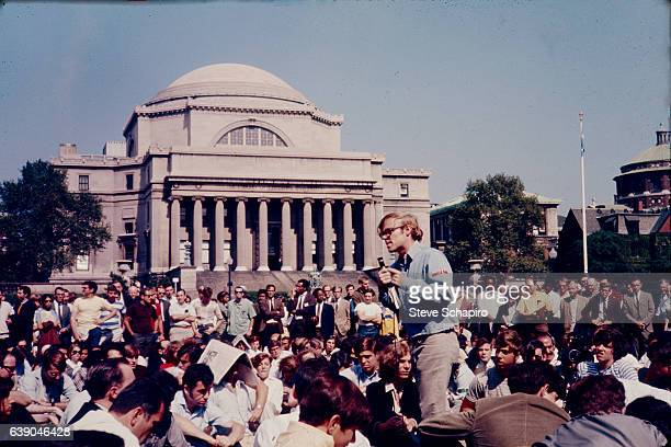 On the mall in front of Low Memorial Library at Columbia University a young man with a microphone student speaks to a crowd of students faculty and...