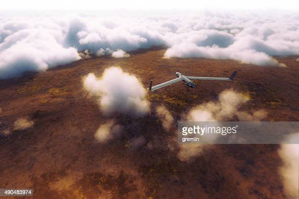 uav on the mission above the clouds - military drones stock photos and pictures