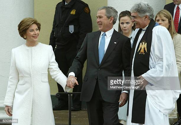 On the morning of his second inauguration US President George W Bush and first lady Laura Bush talk with Rev Luis Leon after attending a church...