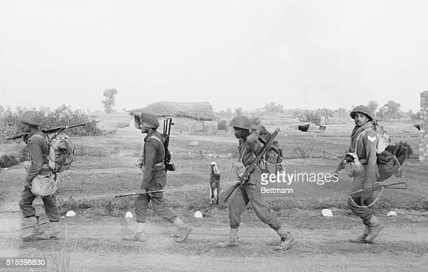 On the Move Puklean Kheri West Pakistan Indian soldiers advance along road 10 miles inside West Pakistan and 35 miles northwest of Jammu Kashmir Dec...