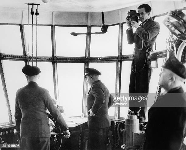 On the occasion of the recent sightseeing flight of the new German passenger Zeppelin LZ129 and the Graf Zeppelin this picture of the control room of...