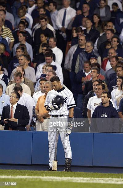 On the one year anniversary of the tragic events of September 11 shortstop Derek Jeter of the New York Yankees bows his head to observe a moment of...