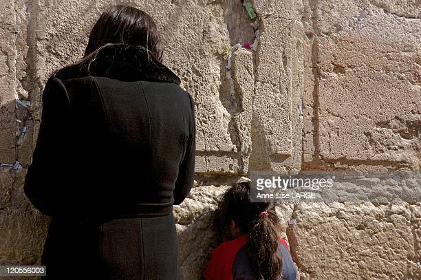 On The Other Side In Jerusalem, Israel On February 02, 2008 - A mother and her daughter praying at the Western Wall, Judaism holiest site-Women seen...