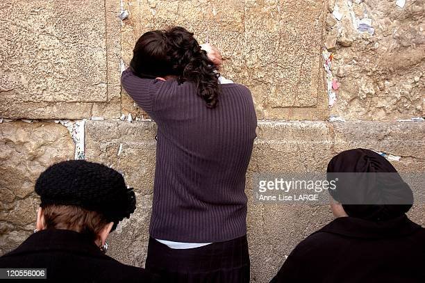 On The Other Side In Jerusalem, Israel On February 10, 2008 - Woman praying at the Western Wall, Judaism holiest site-womanseen from her side of the...