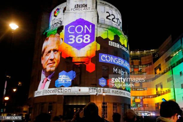 On the outside of the BBC building in London the broadcaster's exit poll results shows Britain's Prime Minister Boris Johnson's Conservative Party...