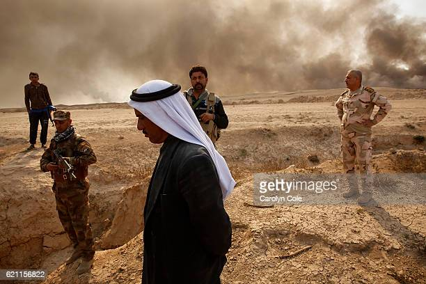 On the outskirts of the village of Al Hud members of the Iraqi Army visit the area where locals say ISIS executed four or five Peshmerga in recent...