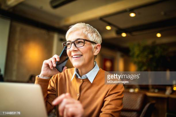 on the phone. - accounting stock photos and pictures